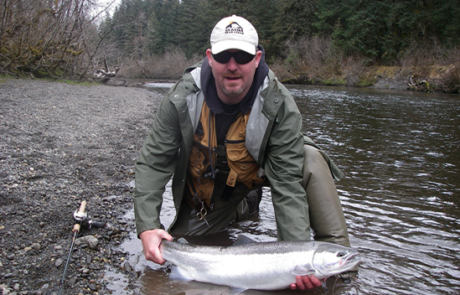 man posing with steelhead